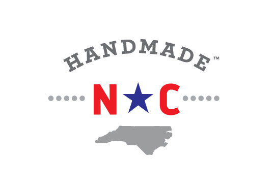 Handmade NC logo an outline of the state of north carolina in gray with blue red and gray text