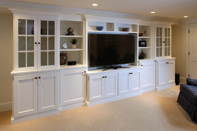 Customized and organized family room storage and media center crafted by our custom millshop