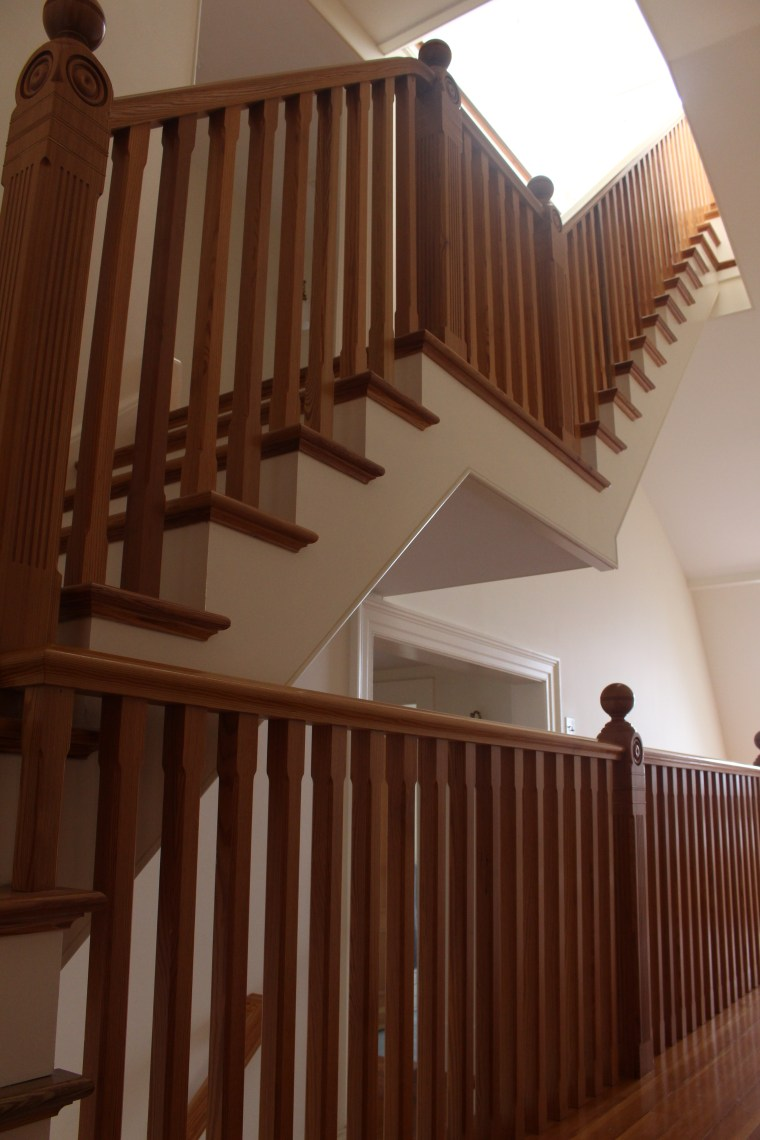 Wood trim, steps and railings on stairway