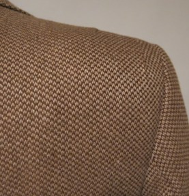 Shoulder treatment has double tuck pleating on both sides at rear keeping in context with the Norfolk styling at the waist.