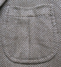 Elegantly shaped, invert pleated patch pockets.