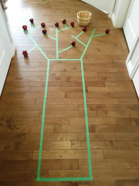 Make a painters' tape apple tree for a fun gross motor activity with lots of movement!
