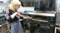 Taysha baking a potato-base pizza in the stone oven. Location: Wholegrain Organics, Kimbolton