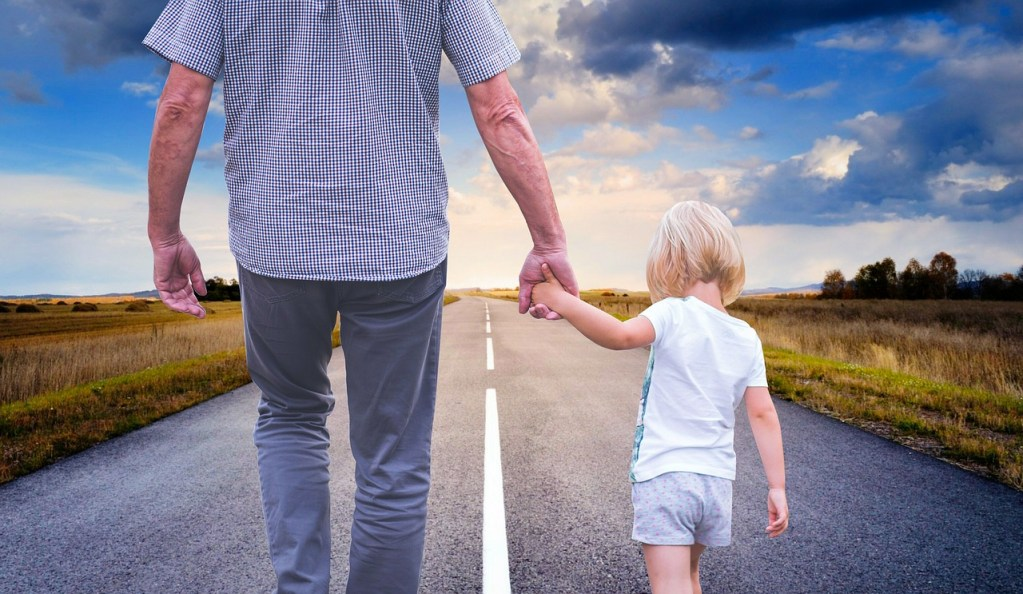 father helping child take a step in the direction of healthy emotional regulation