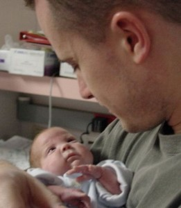Daddy Mike holding Jackson in the NICU
