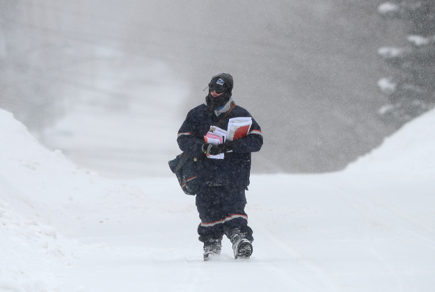 Image of postal carrier in snowstorm, Contact Handy Al, your quality Toronto Handyman