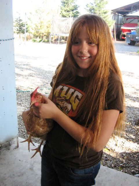 Kristi with a Hen