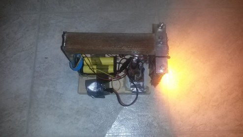 Custom made flashlight with microcontroller based step-up LED driver.