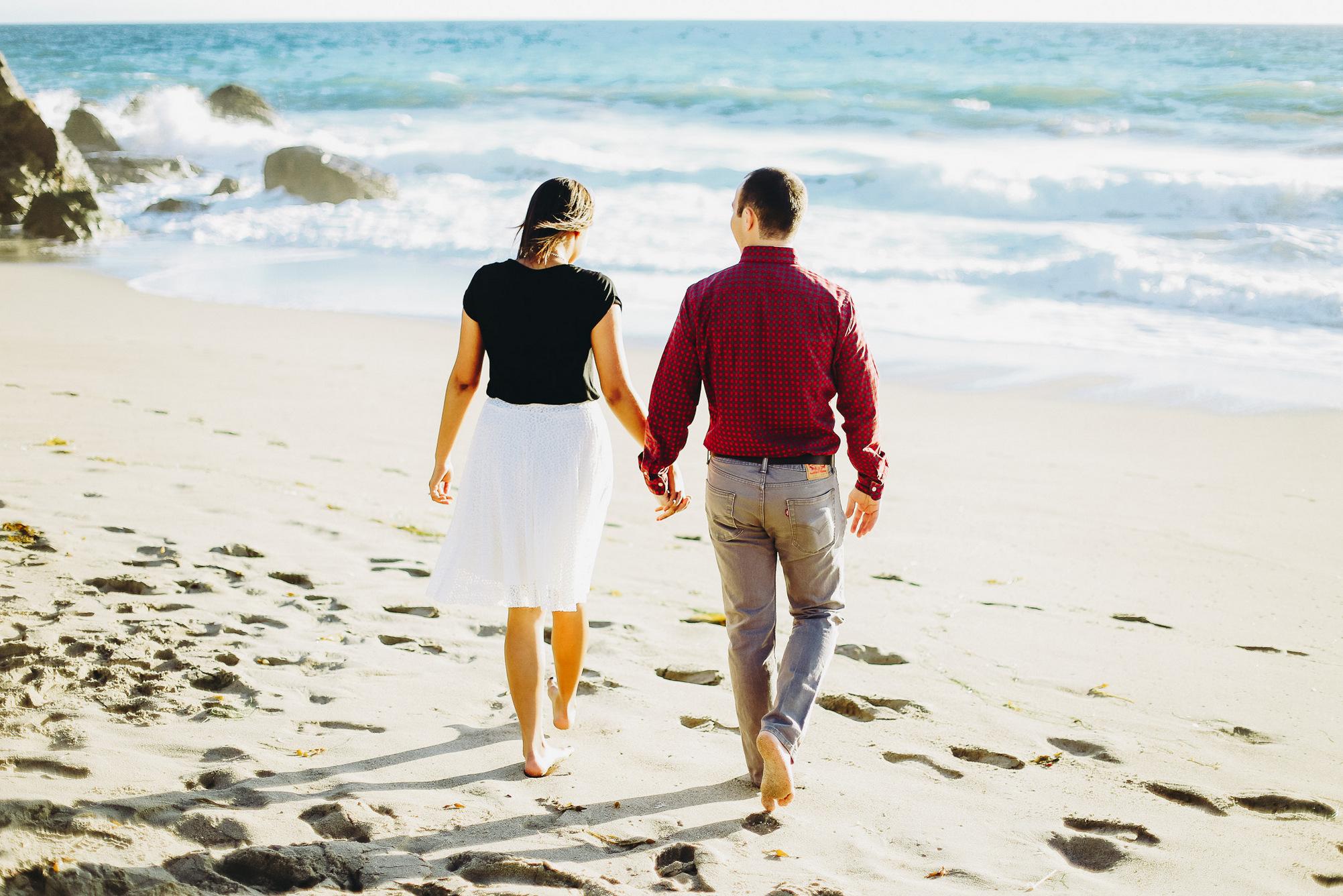 walking barefoot on the beach