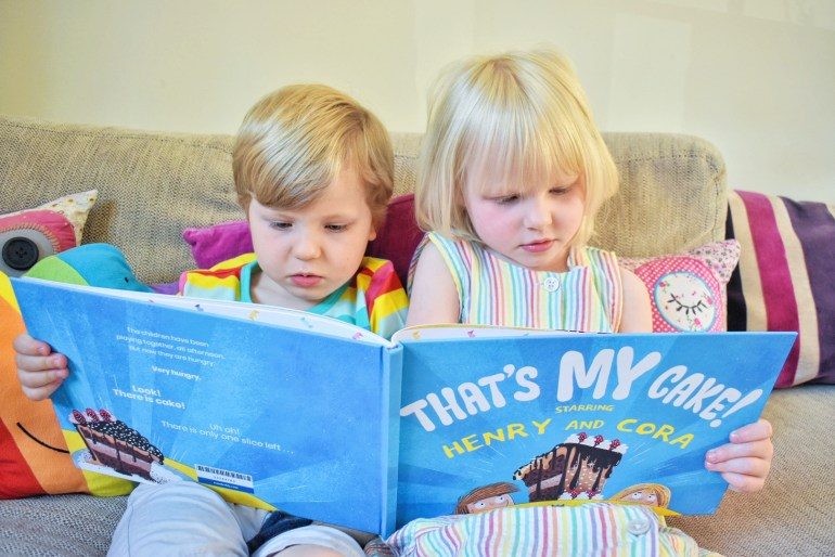 twins reading Wonderbly book