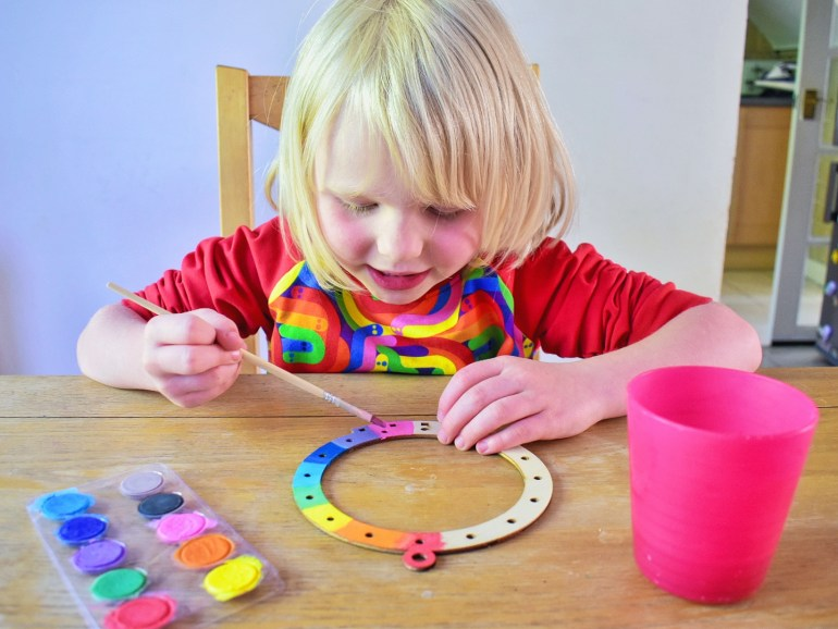 painting a rainbow dreamcatcher
