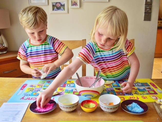 decorating rainbow biscuits