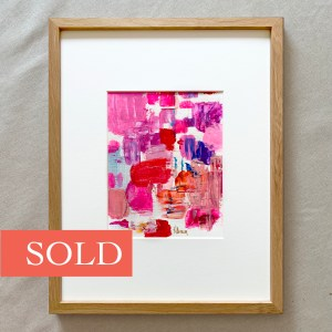 Framed abstract acrylic paint palette with bright pink, red, and purple hues painted by Dallas, Texas artist Hannah Brown.