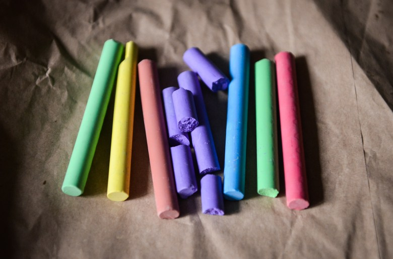 coloured crayons on paper