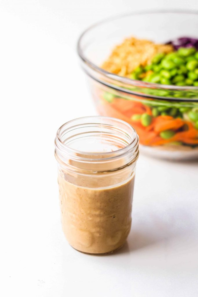This spicy Peanut Dressing is vegan and PERFECT on a fresh asian noodle salad.