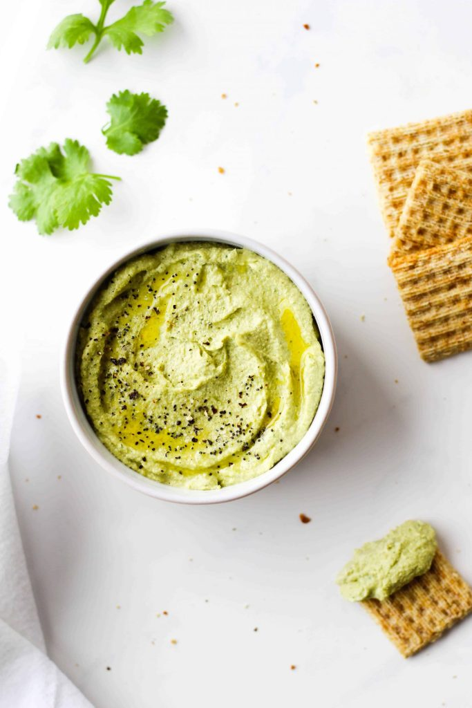 It's packed with cilantro, lime and a little kick! It's higher in protein than traditional hummus thanks to one special ingredient - edamame!