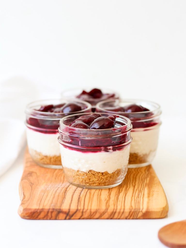 This healthy cheesecake is super simple + quick to make and it's served in mini mason jars.