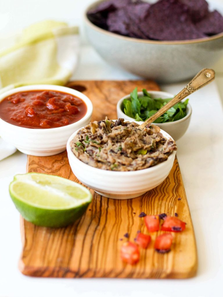 This super easy, healthy refried black beans recipe is the key to all of your quick weeknight meals! Just spread it onto a tortilla, taco shell, or salad with veggies and you've got a protein-packed, plant-based meal!