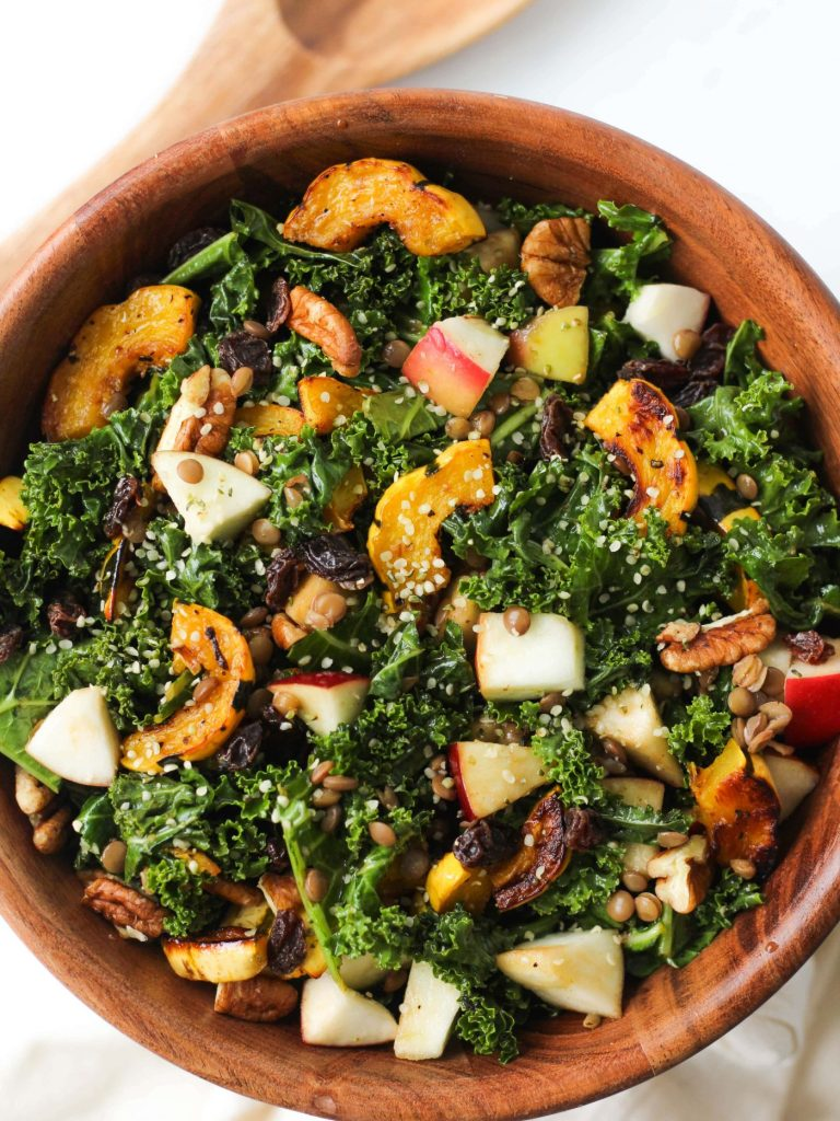 This Autumn Kale Salad features is super delicious and is made with super healthy ingredients! A great, vegan + gluten-free fall and winter recipe!