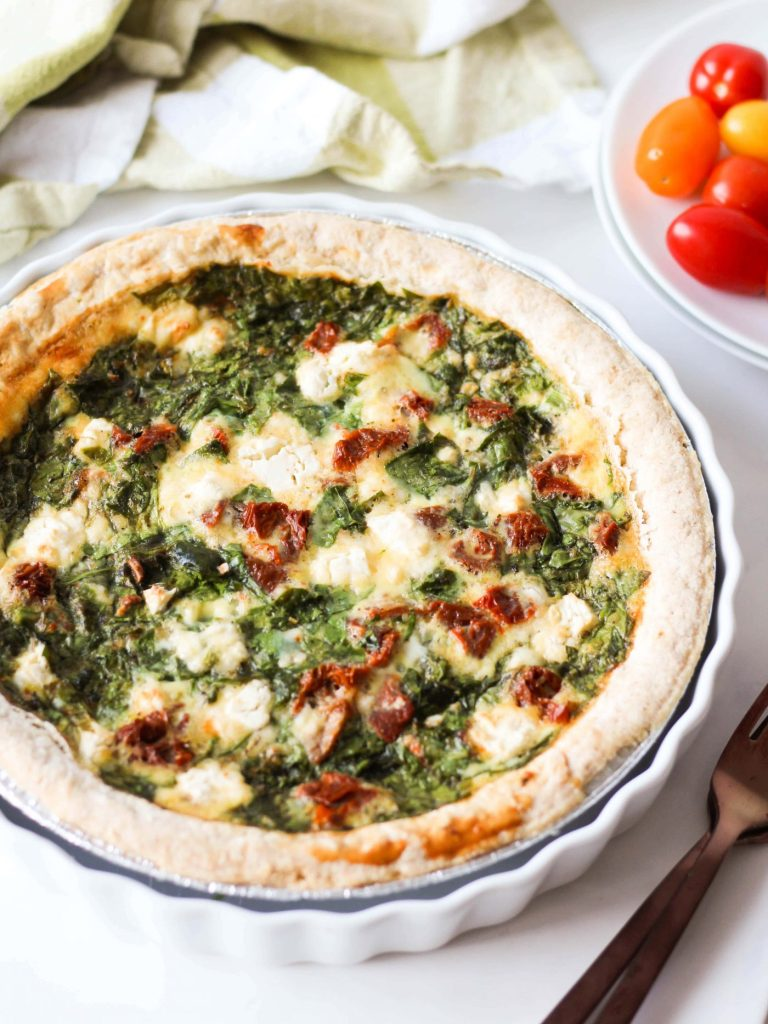 This spinach and sun-dried tomato quiche is an easy, protein- and vegetable-rich dish. It's a great healthy meal to serve for friends and family or meal-prep for the week!
