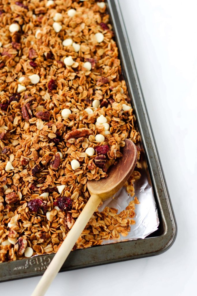This healthy White Chocolate Orange Granola recipe is slightly fruity, sweet and perfect for breakfast or snack time. Vegan and gluten-free, too!