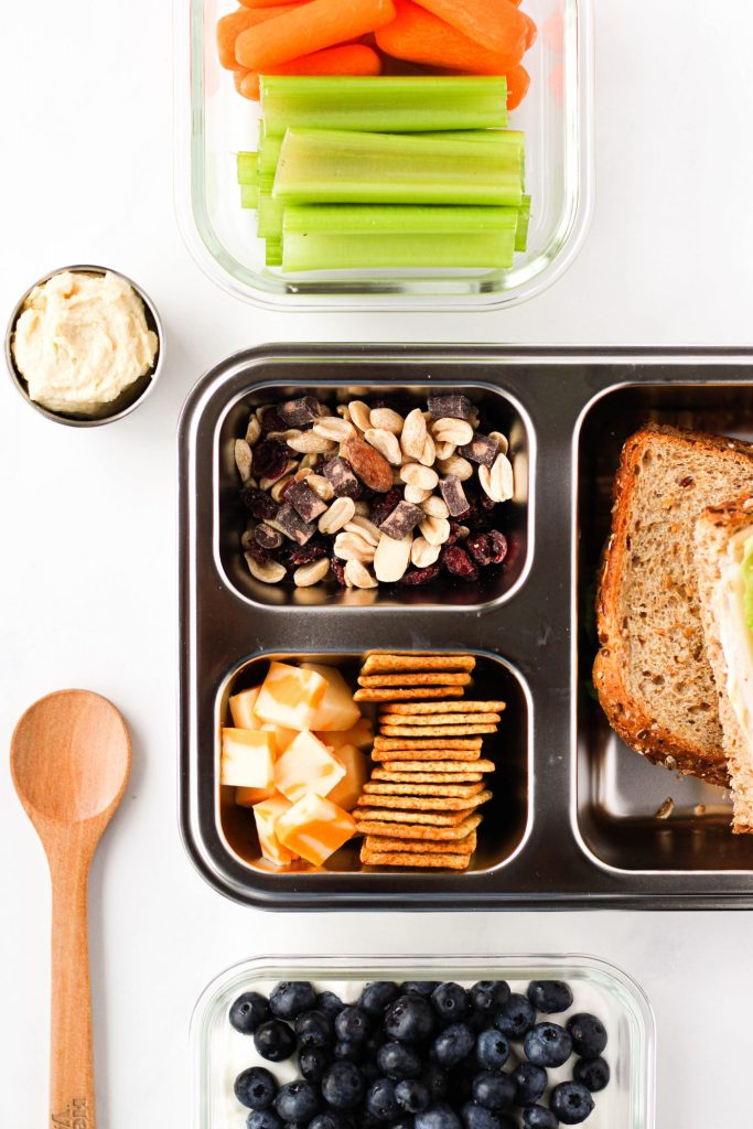 As a dietitian, I have several tips for eating healthy on a road trip. From which snacks to pack, where to store your cooler, and how to prevent bloating on long road trips, read on to hear my tips!
