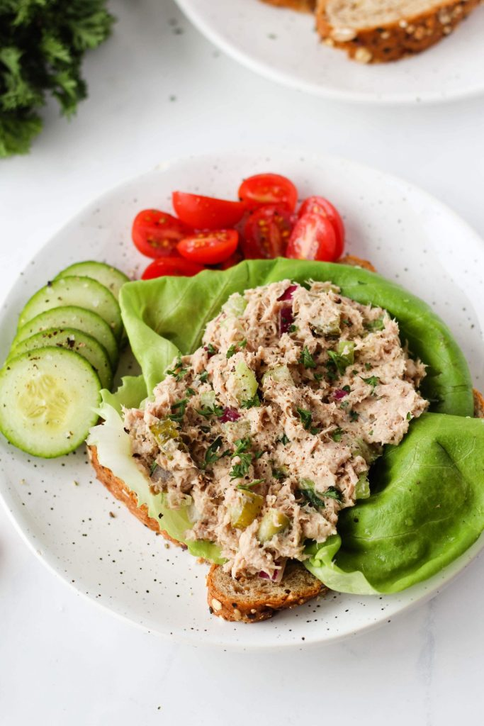 This healthy tuna salad makes a filling, easy lunch or snack. Instead of mayonnaise, we're using hummus and adding celery and red onion. You can serve it on its own, on crackers, sandwiches or toast. It's a delicious dairy and egg-free tuna salad.