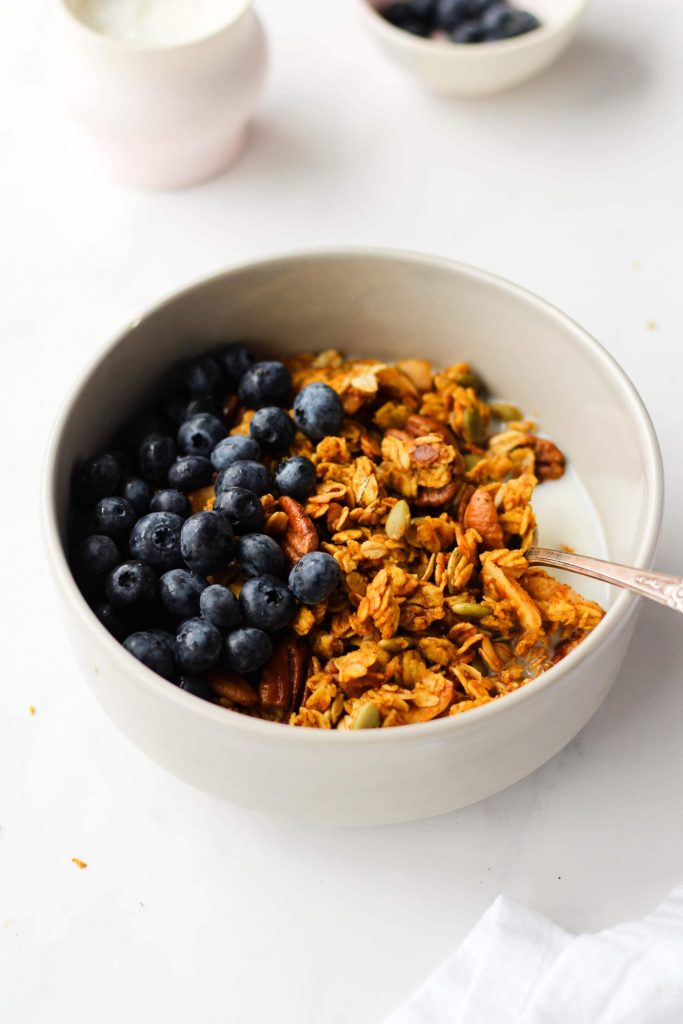 A healthy pumpkin granola recipe that's easy to make, vegan and gluten-free. You'll never want to buy store-bought granola again!