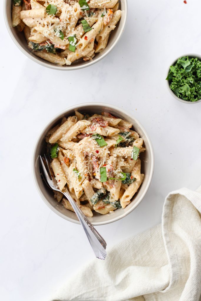 This creamy sun-dried tomato pasta with kale is the perfect mix of nourishing and comforting. Enjoy on its own or pair it with salad or protein like chicken or shrimp for a satisfying, healthy dinner meal.