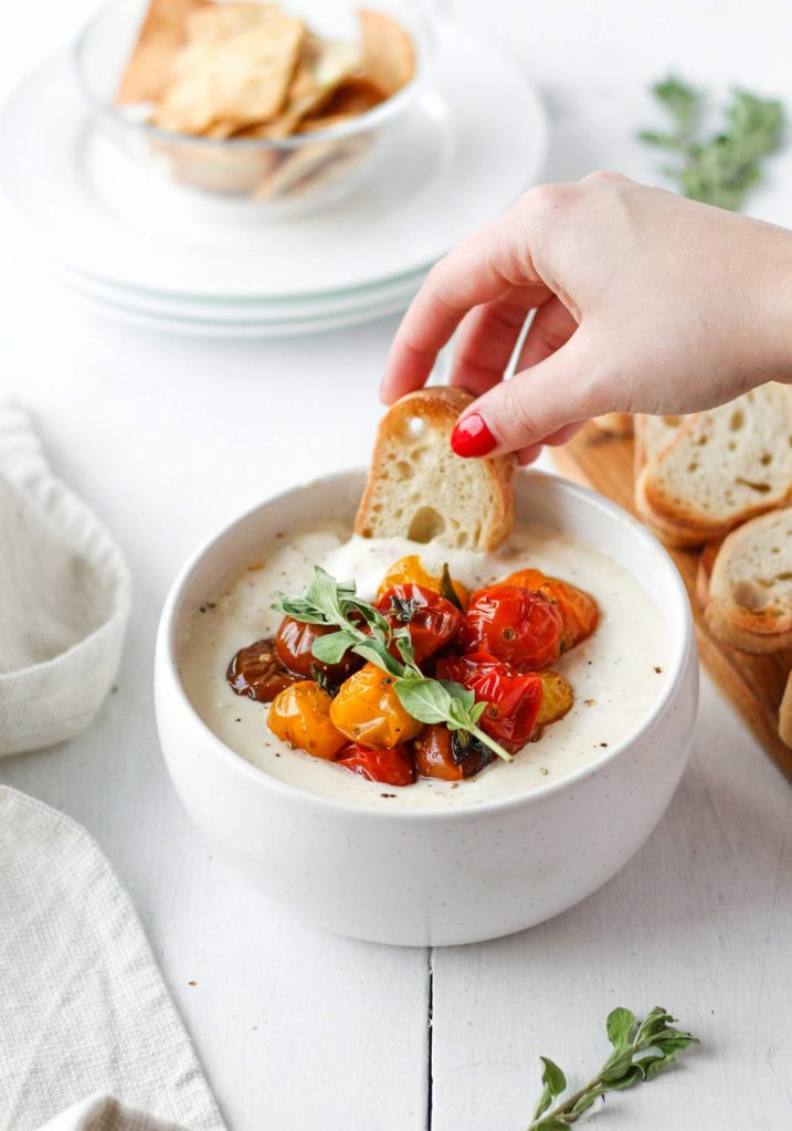Creamy whipped feta dip with garlicky roasted tomatoes is bound to be a crowd-pleasing appetizer. While it seems fancy, it's really quite simple to make.