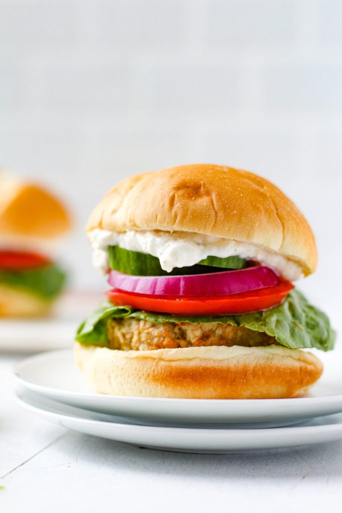 Easy to make juicy greek chicken burgers that are bursting with simple, fresh flavours topped with a creamy feta aioli. Enjoy them year-round with cooking instructions for the grill and the oven included. I recommend serving these burgers on a bun with lettuce, sliced cucumber, tomato and red onion!