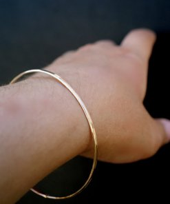 gold bangle jewelry on hand