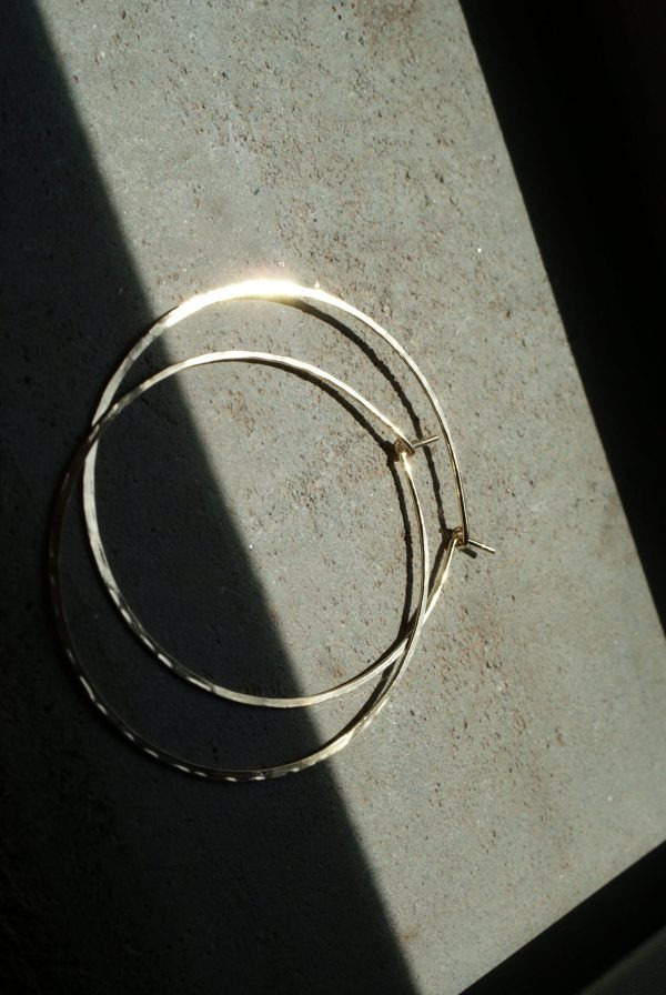gold hoops half in shadow