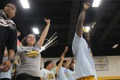 The crowd puts their 'Rams up' during the men's basketball game during overtime. Photo by Hannah Onder