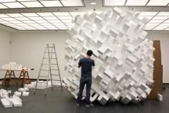 John Powers working in his studio
