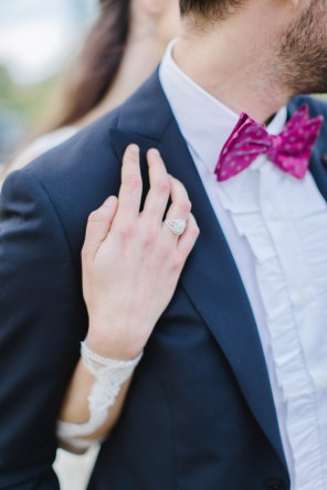 Detail photograph of bride and groom's designer wedding outfits and diamond jewellery by Katia Delatola and Danelian Diamond Club.