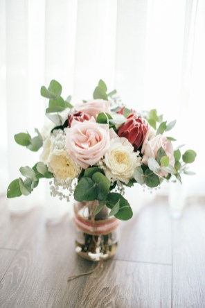Tropical bridal bouquet photographed on a wedding day on the floor of the bridal hotal suite in Crete.