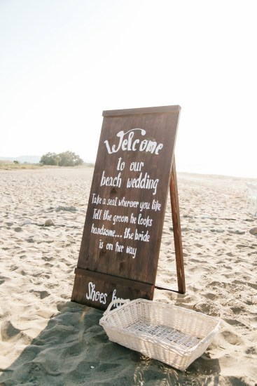 Welcome to our beach wedding sign positioned at the entrance to the ceremony location on the beach in Crete.