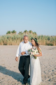 Professional portrait of a father leading the bride down the isle for the wedding ceremony.