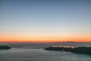 Sunset view of Oia Santorini captured by professional photographer from the caldera terraces of Imerovigli village.
