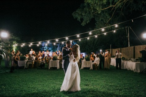 Bride and groom's first dance on an exclusive wedding night in Metohi Kindelis, Chania, Crete photographed by professional photographer team.
