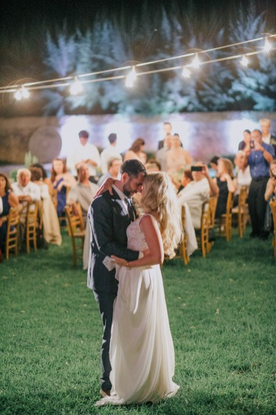 Bride and groom's first dance on an exclusive destination wedding night in Metohi Kindelis, Chania, Crete photographed by professional photographer team.