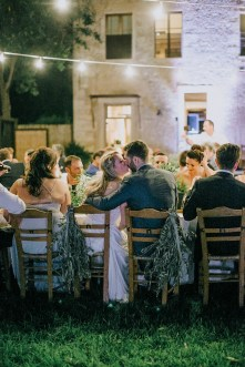 Bride and groom's first kiss on an exclusive wedding night in Metohi Kindelis, Chania, Crete photographed by professional photographer team.