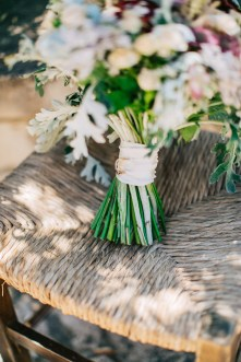 Flower bouquet by Fabio Zardi captured by professional wedding photographer during a destination wedding in Agreco farm in Crete.