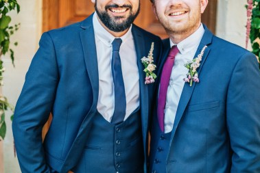 Trendy groom and his classy best man posing for formal portraits after the wedding ceremony at Agreco Farm in Crete, Greece.