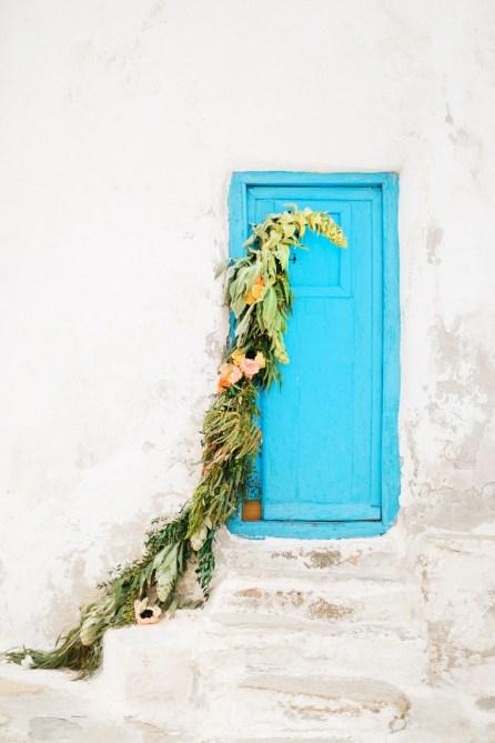 Blue door of the Mykonos windmill with wedding decoration.