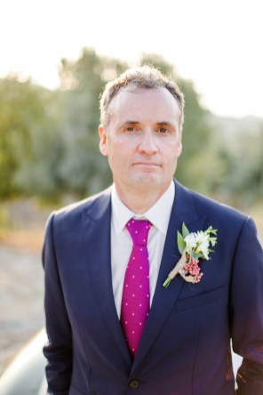 Elegant modern groom posing for wedding day portraits.