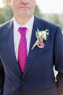 Elegant modern groom posing for wedding day portraits.