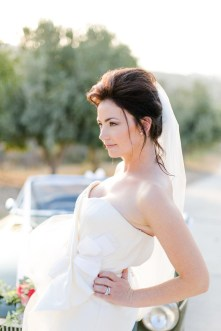 Beautiful modern bride posing for wedding photographer on her wedding day.