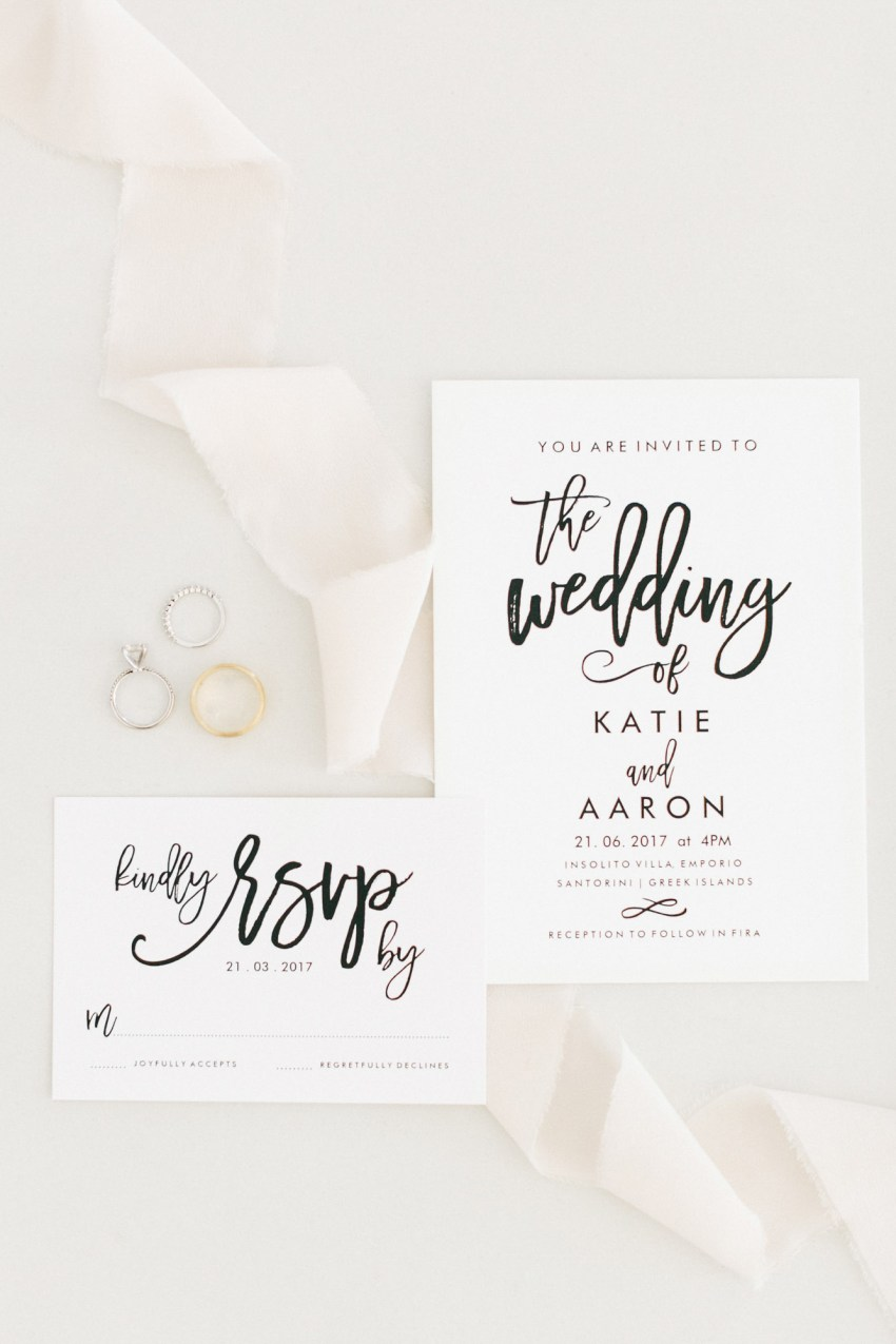 Santorini wedding invitation stationery suite with wedding rings.